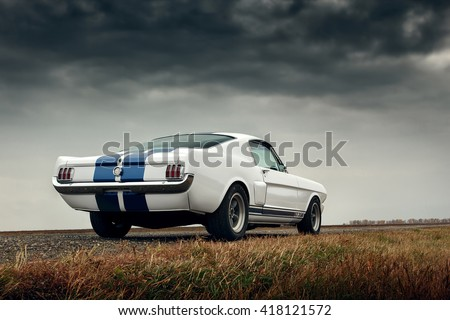 Saratov, Russia - October 17, 2014: Old car Ford Mustang Shelby on the road
