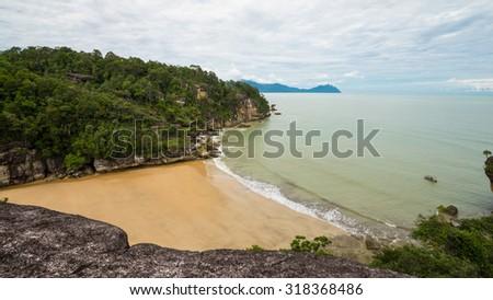 SARAWAK, MALAYSIA - 27TH NOVEMBER 2014; Beautiful shoreline and dramatic sky from Bako National Park, West Sarawak, Borneo, Malaysia. - stock photo