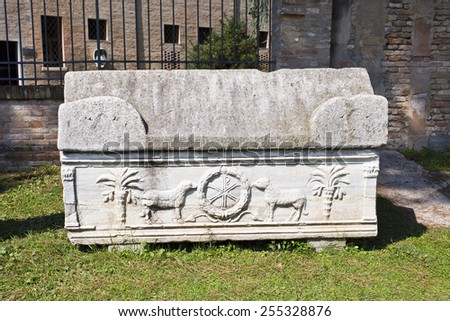 Sarcophagus in the Basilica of San Vitale courtyard, in Ravenna, Italy - stock photo