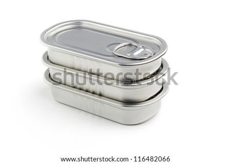 sardine cans stacked isolated on white background - stock photo