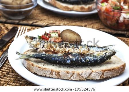 sardine sandwich, sardine on plate - stock photo