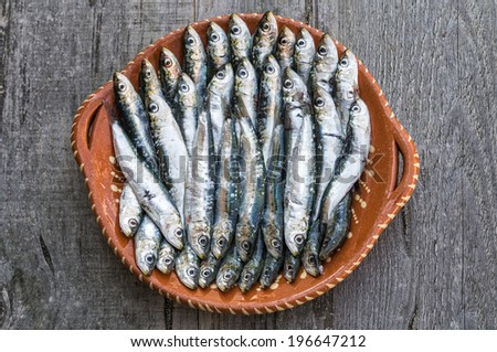 Sardines in wooden background - stock photo