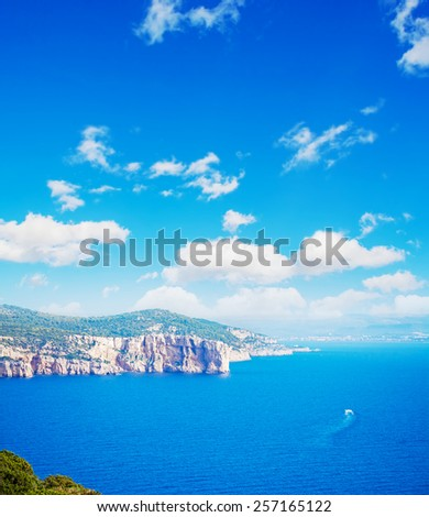 Sardinia coastline seen from capo caccia on a cloudy day - stock photo