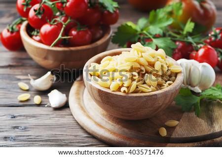 Sardinian uncooked pasta malloreddus, selective focus - stock photo