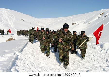 SARIKAMIS, TURKEY - DECEMBER 26: Turkish soldiers walking at Sarikamis Allahuekber Mountains on December 26, 2006 in Kars, Turkey. Hiking done for, Turkish soldiers who died in 1915 Sarikamis. - stock photo