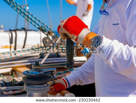 SARONIC GULF, GREECE - MAY 31, 2013: Action on a sailing boat during a regatta at Saronic gulf near Athens Greece on May 31, 2013 - stock photo
