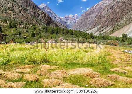 Sarytag village and mountain landscape of Fan Mountains in summer, Tajikistan, Central Asia - stock photo