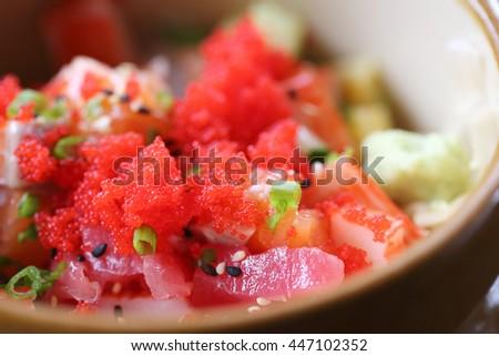 sashimi seafood and egg rice bowl - mix sashimi donburi , japanese food - stock photo