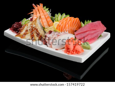 Sashimi seafood assortment on large triangle plate - stock photo