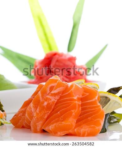 Sashimi with ginger and wasabi over white background - stock photo
