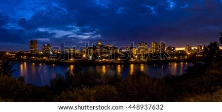 SASKATOON, CANADA - JULY 2: Saskatoon skyline along the Saskatchewan River on July 2, 2016 in Saskatoon, Saskatchewan, Canada. Saskatoon is the largest city in Saskatchewan. - stock photo