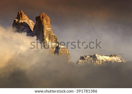 Sass Maor mountain in clouds, mountain group Pale di San Martino, Dolomite mountains - Italy, Europe, UNESCO World Heritage Site - stock photo