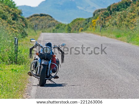 SASSARI, ITALY-MAY 09, 2013: motorcycle parked in a country road - stock photo