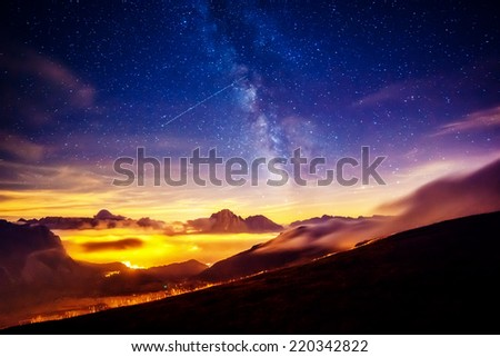 Sassolungo (Langkofel) and Sella group under starry light. Natural park Dolomites, valley Gardena, South Tyrol. Location Ortisei, S. Cristina and Selva, Italy, Europe. Astrophotography. Beauty world. - stock photo