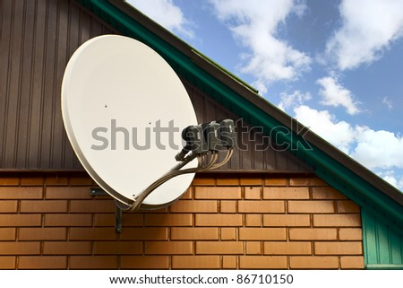 satelite is attached to the wall of the house - stock photo