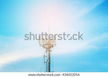Satellite antenna on the blue sky. - stock photo