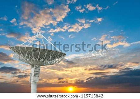 satellite antenna with sunset - stock photo