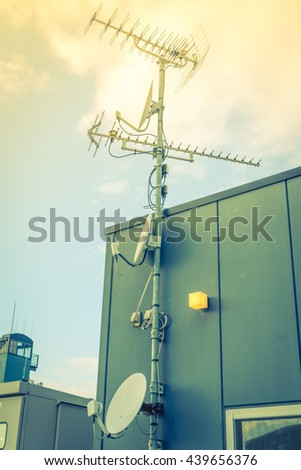 Satellite Dish and Antenna TV  ( Filtered image processed vintage effect. ) - stock photo