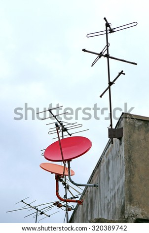 Satellite dish and attenna on a old building - stock photo