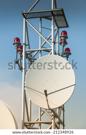 Satellite dish antenna on roof of the building - stock photo