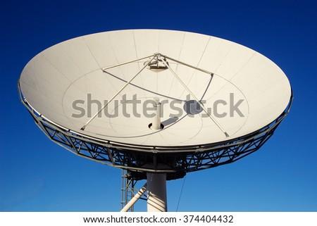 Satellite dish antenna with blue sky.Satellite dish antenna - stock photo