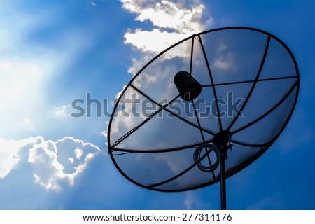 satellite dish antennas on blue sky Background - stock photo