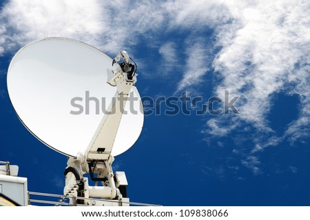 satellite dish antennas with blue sky - stock photo