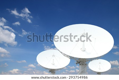 satellite dish antennas with blue sky - stock photo
