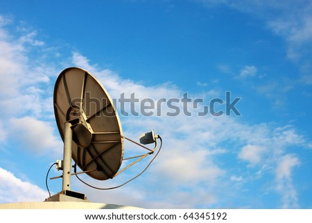 Satellite dish on blue sky - stock photo