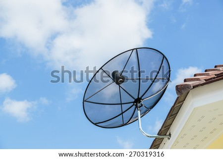 Satellite dish on the roof - stock photo