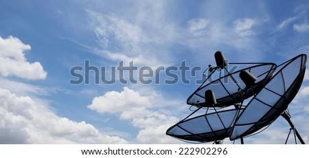 Satellite dish sky sun blue sky communication technology - stock photo