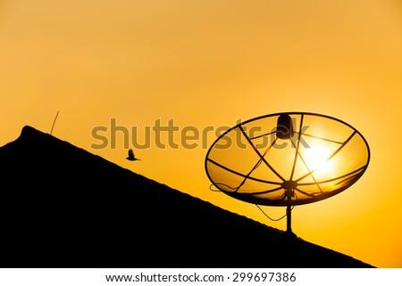 Satellite dish sunset communication technology network. - stock photo