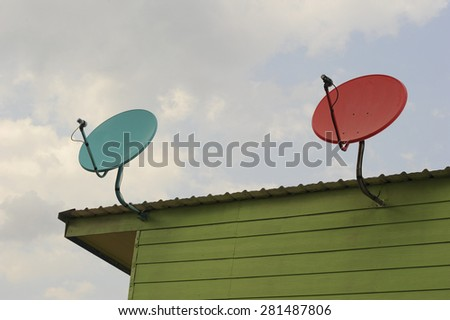 Satellite dish transmission data on background  blue sky. - stock photo
