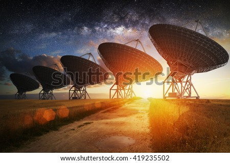 Satellite dish view at night with milky way in the sky - stock photo