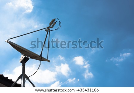 Satellite dish with a beautiful blue sky.    - stock photo