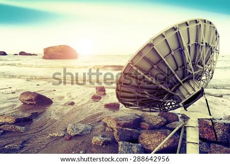 Satellite dishes at beautiful sunrise background - stock photo