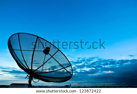 Satellite dishes on the top of building in the evening