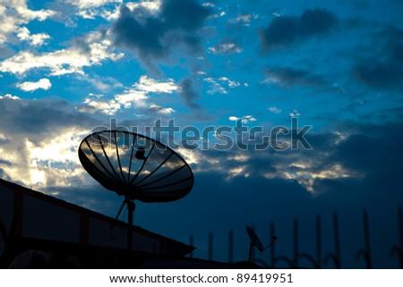Satellite in the morning sky - stock photo