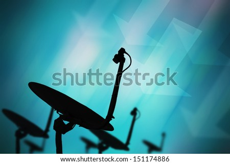 Satellites dish on abstract blue background - stock photo