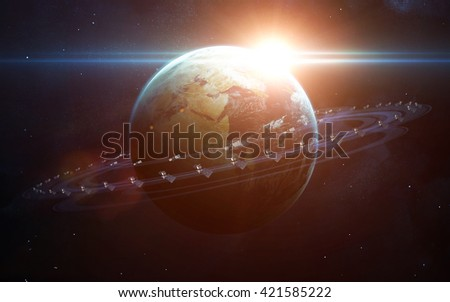 Satellites surrounding the planet Earth. Elements furnished by NASA - stock photo