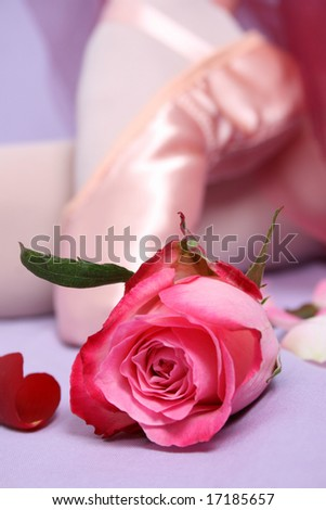 Satin Ballet shoe with a pink rose.  FOCUS ON ROSE