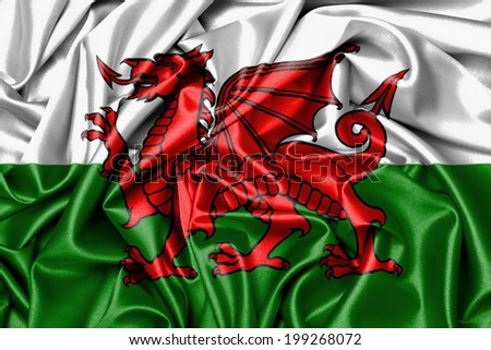 Satin flag, printed with the flag of Wales - stock photo
