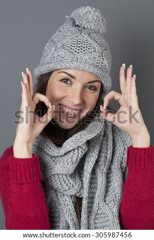 satisfaction concept - thrilled young brunette woman making the ok sign for agreement