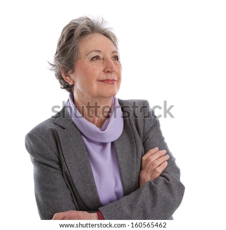 Satisfied and happy older woman isolated over white in winter clothes.