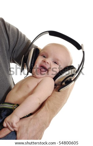 satisfied baby on the hand of the father in receivers on the white background - stock photo