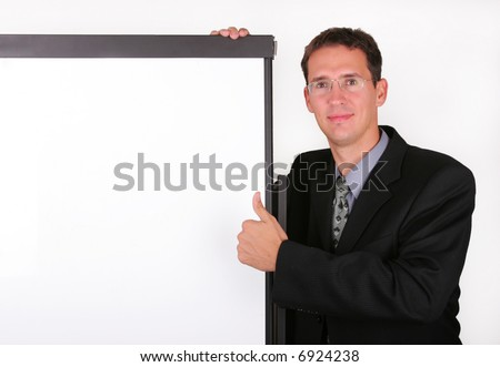 Satisfied business men at the whiteboard - stock photo