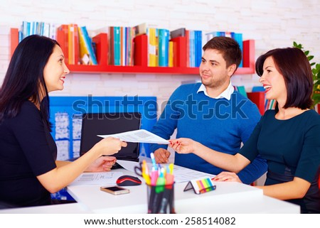 satisfied clients during business negotiations in office - stock photo