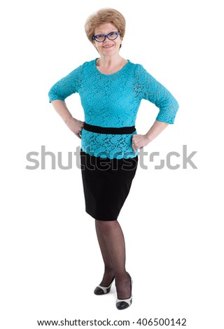 Satisfied elderly Caucasian woman in black skirt and blue blouse in full length, isolated on white background
