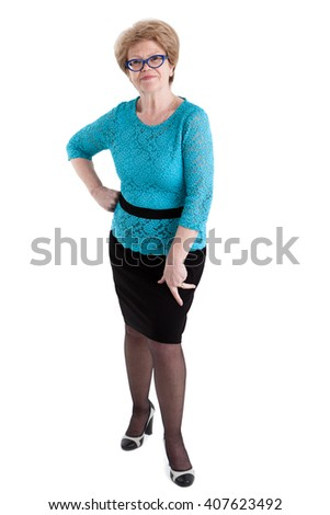 Satisfied senior Caucasian woman posing in black skirt and blue blouse in full length, isolated on white background - stock photo