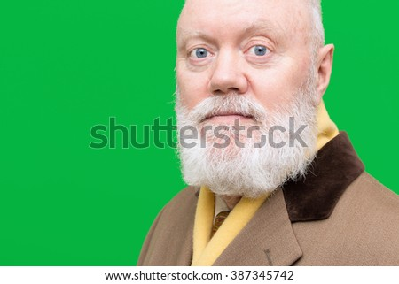 Satisfied senior is posing on green background, color and contrast manipulated - stock photo